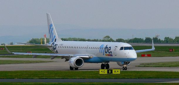 Flybe Embraer 195 (G-FBEH) taxis at Manchester Airport, UK