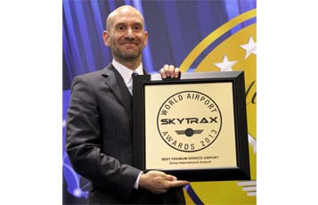 Qatar Airways Vice-President Commercial North, South & Western Europe Paul Johannes Paul Johannes, Vice President Commercial Europe Qatar Airways, collects the award for Best Premium Service Airport on behalf of the airline at the Skytrax 2013 World Airport Awards World's held at the Passenger Terminal EXPO in Geneva.