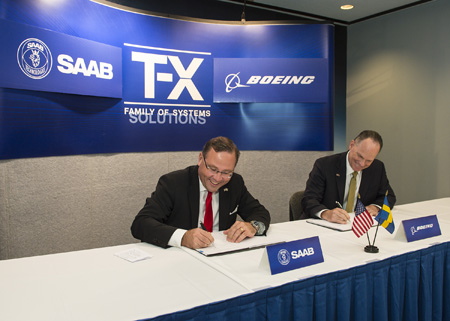 Saab President and CEO Håkan Buskhe, left, and Boeing Military Aircraft President Chris Chadwick sign the Joint Development Agreement document. Author: Boeing