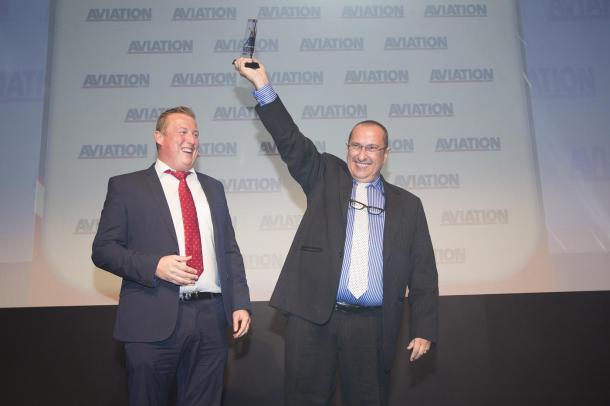 Senior Director of Jet Aviation's Dubai FBO Philippe Gerard proudly raises FBO of the Year award