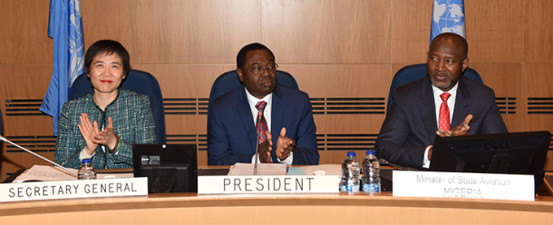 Dr. Olumuyiwa Benard Aliu of Nigeria (centre) is congratulated on his re-election as Council President by the Representatives of the ICAO Council. Seated with him on the occasion are ICAO Secretary General, Dr. Fang Liu (left,) and Nigeria's Minister of State Aviation, Hadi Sirika (right).